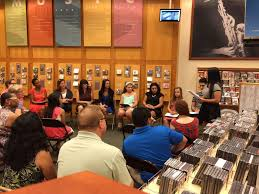 bookseller seeks nominees for best teacher contest com lisveth trejo of plant city high school standing right reads her winning essay about