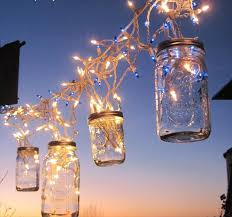 adding an outdoor mason jar chandelier is a great way to add flare to your outdoor space here s how to diy