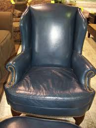 entertaining leather wingback chair with nailhead trim
