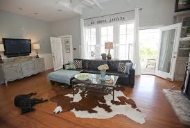Decorating with cowhide rug living room farmhouse with cowhide rugs brown  blue scheme blue and brown