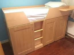 captain bunk bed with storage shelves and desks