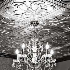 faux tin ceiling tiles and charming decor with antique chandelier make the room look beautiful good lighting embossed metal interior paint install metallic