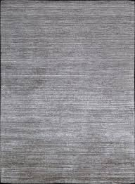 natural elements showcased in these fine handmade silk like bamboo fiber rugs cool clear colors reminiscent of earths minerals shine and illuminate