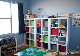 Those shelves from Ikea are the best! Some of my favorite things about the  new way the room is set up are the buckets on the bottom shelf (red, ...