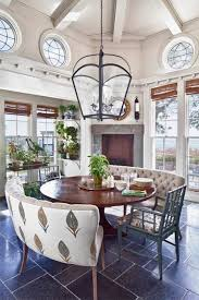 curved settee dining antique pendant light above wood round dining table furniture for
