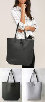 this reversible grey vegan leather tote has a tie closure to make sure all the contents of your bag stay inside