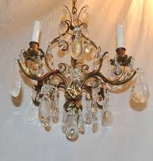 petite gilt and rock crystal four light chandelier wonderful gilt scrolls decorated with fl