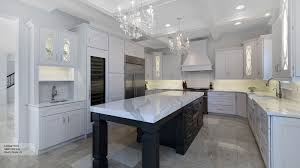 white kitchen. White Kitchen Cabinets With A Dark Grey Island