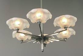 3 here s a spell binder a sunburst french art deco chandelier sporting six ezan opalescent shades opalescent shades look fabulous lit when their rich