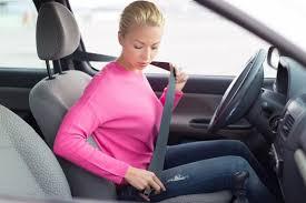 lady fastening her car seat belt