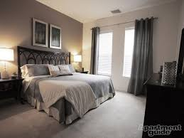 Mustard, black, cream and gray bedroom color scheme