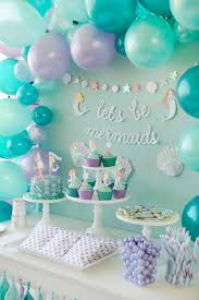 Mermaid themed children's birthday party - could be easily adapted to a  baby shower theme - Mermaid Party styling by Happy Wish Company.