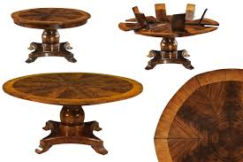round mahogany dining table with self storing leaves