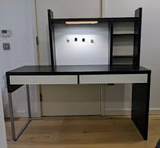unused ikea black two drawer micke desk workstation with add on unit and light