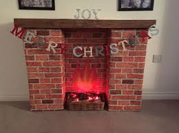 homemade fireplace cardboard bo covered in brick wallpaper and wood effect vinyl fake fireplacedecorative fireplacediy