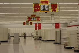 to enlarge an employee walks through the empty aisles of tucson s last kmart