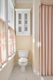 beautiful pink girl s bathroom features cream walls accented with pink and cream fl cafe curtains complementing a pink valance paired with a pink shower