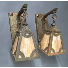 antique brass hammered arts crafts wall sconce pair with caramel slag glass shades