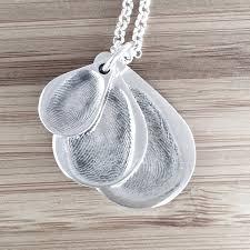 descending original fingerprint pendants on fine belcher chain