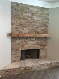 my faux stacked stone fireplace this is coronado proledge in oakbrook color it is actually concrete made to look like real stone the hearth is 3cm thick