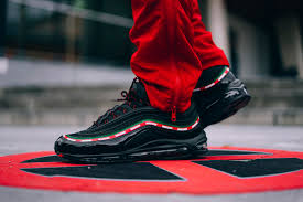 gucci 97 nike. undefeated links with nike sportswear on a special air max 97 colorway that pays homage to the 20th anniversary of runner. seen here is gucci 2