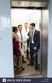 people in elevator. doctors and business people in elevator a