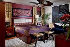 View in gallery Brilliant Asian-inspired bedroom in rich purple and gold