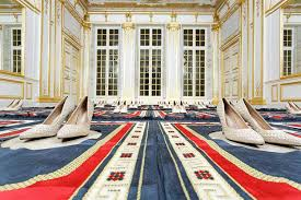 French artist withdraws prayer rug installation from show after