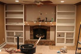 how to build shelves around fireplace between the shelves we also used dry wall