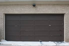 the tips and tricks to painting a garage door