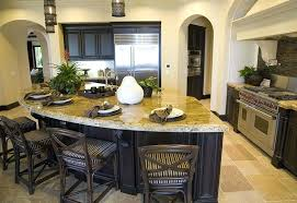 kitchen with yellow granite counters and curved eat in island countertop overhang
