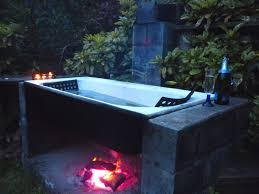 tub outdoor wood fired olive green watercheck if it s hip here archives the hottug a motorized floating