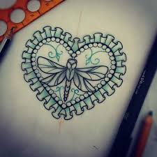 Little dragonfly in lace decorated heart frame tattoo design