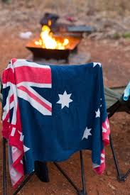 hanging beach towel. Australian Flag Beach Towel Hanging On A Chair At Campsite