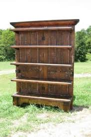 double doors shelves shows the charm of the old doors but is really funtional with lots of display e
