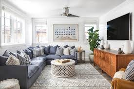 comfy blue sectional with gray moroccan rug