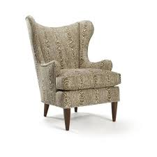 woodland whimsy defines this stylish wingback chair wrapped in faux bois upholstery and highlighted with nailhead trim this captivating seat adds organic