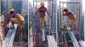 Malaysia Reveals Of Perils In Work Video Construction Chilling 0qZxRngZ