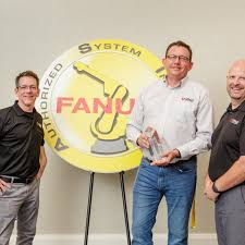 RND Automation - From left Chris Conley , Sean Dotson, and Aaron Laine of  RND were proud to accept a Growth award for robot sales at the FANUC  America Corporation conference. #fanuc #