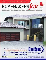 framed horizontal grooved double garage door on the front cover of the homakersfair december 2018