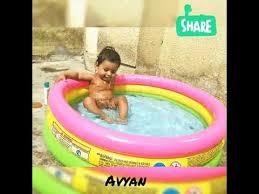 indian baby bath in bath tub swimming pool funny movements
