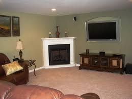 wonderful corner fireplace decorating ideas white painted surround fireplace mantel brown varnished wood credenza shelves beige