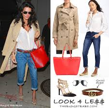 actress angie harmon looks chic and sophisticated in a burberry trench white shirt cuffed