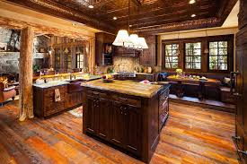 a rustic kitchen island designs in a rustic kitchen with pendant lights above surrounded by sets of rustic furniture such as dining table with bench seating
