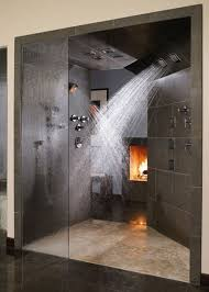 futuristic rainfall shower head mixed with doorless shower design and electric fireplace with dark grey tile
