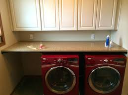 washer dryer countertop pedestal laundry room transitional