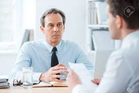 the office the meeting. Business Meeting. Two People Sitting In Front Of Each Other The Office While Meeting O