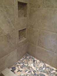 18quotx 18quot porcelain tile on the walls with flat river rocks texas 18x18 peruvian ceramic floor