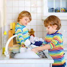 boys washing dishes. Exellent Boys Stock Photo  Two Little Kid Boys Washing Dishes In Domestic Kitchen On Boys Washing Dishes N