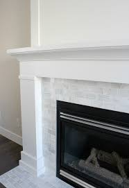 white painted fireplace with marble subway tile the makeover details satoridesignforliving com
